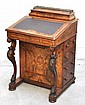 A Victorian walnut and inlaid Davenport, the