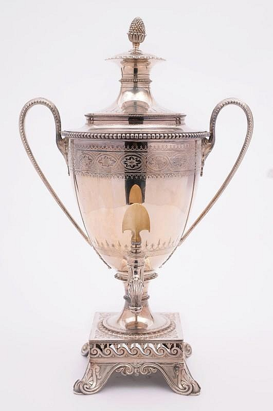 A Victorian plated tea urn and cover of Adam vase