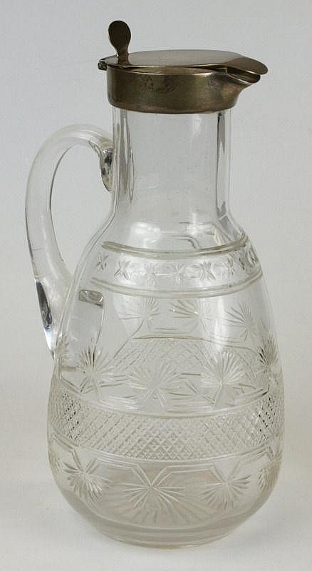An Edwardian silver mounted cut glass claret jug: