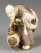 A Japanese carved ivory netsuke of a samurai