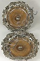 A pair of plated shaped circular wine coasters,
