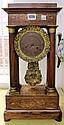A rosewood and inlaid portico mantel clock of