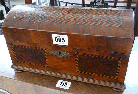 An 18th century walnut domed casket, with