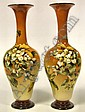 A pair of Doulton Lambeth faience vases of