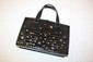 GIANNI VERSACE-Sac port main en cuir faon crocodile noir et incrustations de pierreries et de petits sigles et motifs gomtriques en mtal, intrieur en cuir noir avec deux poches dont une zippe (un des derniers modles raliss avant la mort du