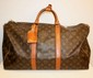 VUITTON - sac modle keepal 50 cm, toile monogramme , garniture   en cuir vachette, serre poigne, bon tat.