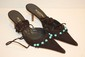 MERCEDEH - Paire de mules en crote de cuir et perles turquoises, laage  la cheville. Taille 37,5. etat neuf.