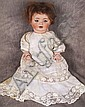 GERMAN BISQUE CHARACTER BABY.  With composition body.  Mold #10.  Attributed to