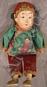 OLD CHINESE COMPOSITION DOLL.  With embroidered silk costume and painted feature
