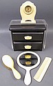 CELLULOID DRESSER SET. With scarce clock and a