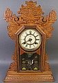 WATERBURY OAK KITCHEN CLOCK. With unusual