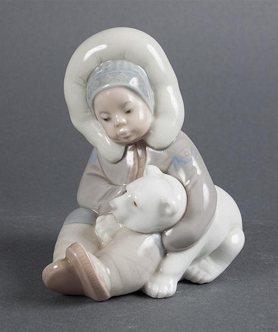 Lladro porcelain Eskimo child with polar bear cub