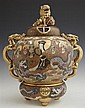 Japanese Satsuma Baluster Form Incense Burner, early 20th c., the lid with a foo dog finial, the sides with gilt and moraige figural...