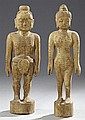 Pair of Chinese Carved and Painted Wood Figures, 20th c., the standing figures of a man and a woman marked with the names and places...