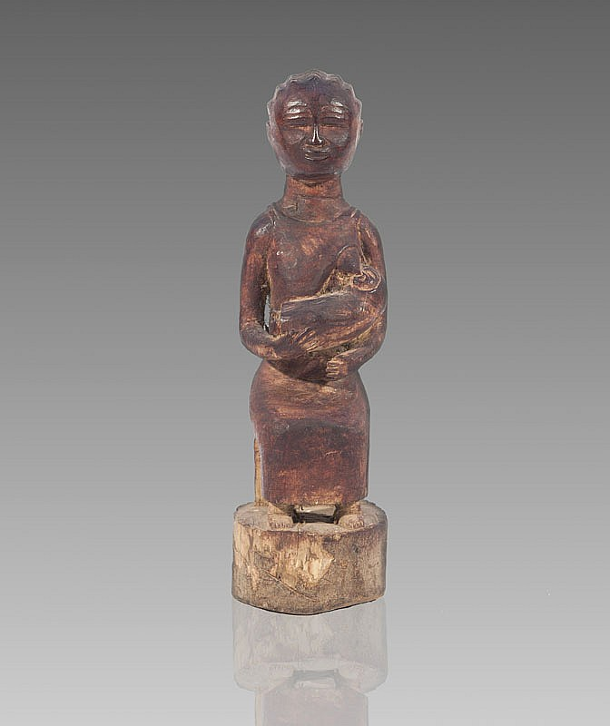 Maternit colon  BAOUL, Cte d'Ivoire.  Femme assise donnant le sein.  Bois  patine brun rouge.  H. : 29 cm.