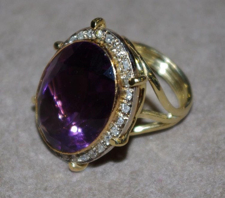 Large gold & amethyst ring set with diamonds.