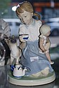 Lladro figure of a girl with Siamese cat