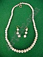 Graduated coral bead necklace and a pair of earrings ensuite
