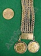 Unmarked gold 8 strand curblink bracelet, hung two 20 franc coins ( 1854/ 1911) and a loose full sovereign 1966.