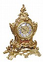 A French Louis XV style ormolu mantel clock,
