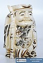 A decorative carved bone oriental figure with