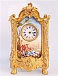 BRONZE AND PORCELAIN TABLE CLOCK