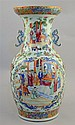 19th century Chinese Canton famille rose baluster vase decorated with figures in an interior,