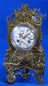 French brass mantel clock, with white enamelled dial and twin train movement,