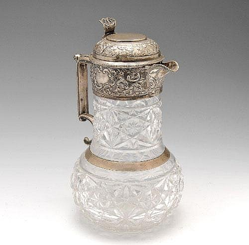 An early 20th century silver mounted and cut glass claret jug, Goldsmiths & Silversmiths Co.