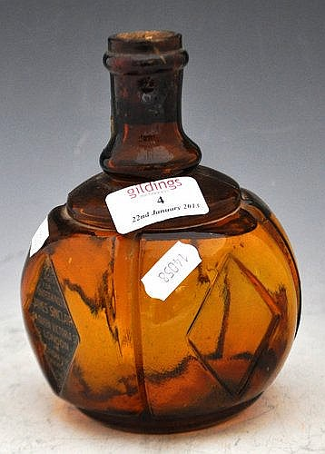 Hayward's hand fire grenade, in amber glass, with