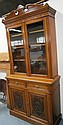 A late Victorian walnut cabinet bookcase, with