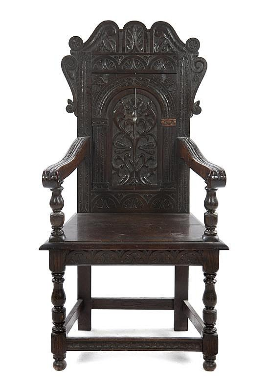 * A Renaissance Revival Open Armchair, Height 40 1/2 inches.