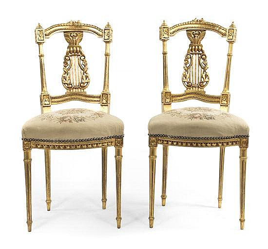 * A Pair of Neoclassical Giltwood Side Chairs, Height 34 1/2 inches.