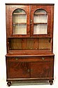 A Narrow Mahogany Bookcase Cabinet, the moulded