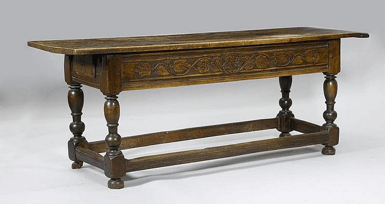 A CARVED WALNUT REFECTORY TABLE, Valais, dated