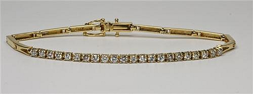 AN 18CT GOLD DIAMOND BRACELET; centring 22 round brilliant cut diamonds totalling an estimated 0.93ct, VS - SI, to a box clasp with....