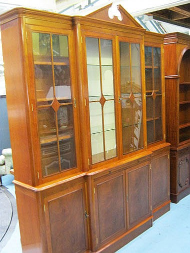 GLAZED BREAKFRONT CABINET, in mahogany finish with