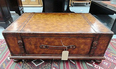 LOW TABLE, modelled as a trunk, in strapped brown