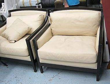 ARMCHAIRS, a pair, in cream leather on ebonised