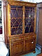 BOOKCASE, yewwood, glazed doors above with drawers and doors below, 115cm wide.