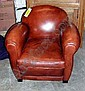 ARMCHAIRS, a pair, in brown leather, Club style, 88cm W. (2)