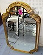 MIRROR, with arched top, in an ornate gilded and