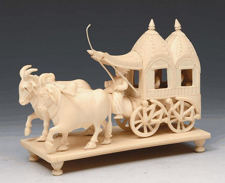 AN INDIAN CARVED IVORY CART drawn by two bullocks