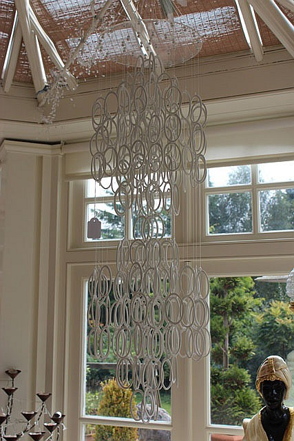 A PORCELAIN WIND CHIME hanging approximately 46