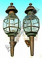 A PAIR OF VICTORIAN BRASS AND GLASS CARRIAGE LAMPS with engraved decoration, 22in high.(see illustration)