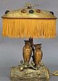 Bronze owl lamp having cast bronze base consisting of tree trunk and vine with two owls resting on branches, owls are set with amber...