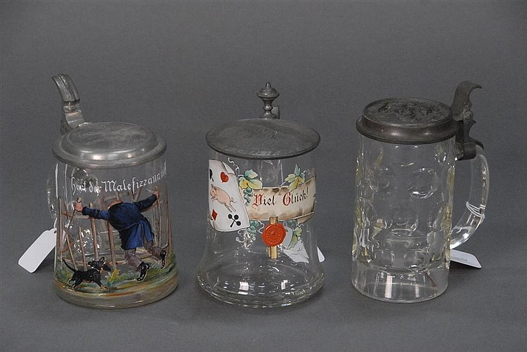 Three clear glass steins with pewter tops, two with enameled scenes, tallest: ht. 7in.