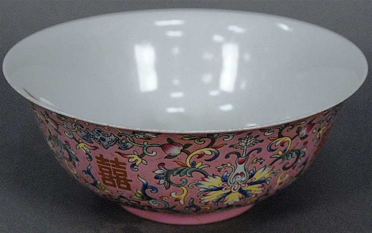 Famille rose pink ground deep bowl Daoguang seal mark in underglaze red, painted in gilding four Shuangxi characters between lotus b...
