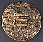 A CHINESE QING DYNASTY GILT BRONZE CIRCULAR PLAQUE