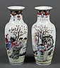 PAIR OF CHINESE PORCELAIN FAMILLE ROSE VASES - Painted with a portrayal of members of the court in a garden setting. Four character...